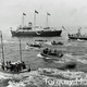 Royal Yacht Britannia with Royal Party aboard reviewing Fleet